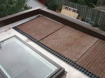 Green roof substrate: a plastic sheet with water-holding cups, and a layer of felt.