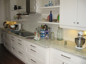 LED under cabinet lights brighten our new granite countertops