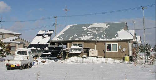 Solar panels partly covered in snow